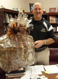 Mr. Jones receives a gift from the staff on Boss's Day.