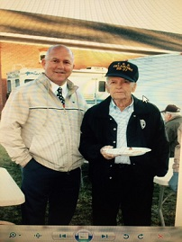 Mr. Jones visits with Alton Mahaffey, a graduate of FHS and Pearl Harbor survivor.  Mr. Mahaffey was the Grand Marshall of the 34th Annual Florien Free State Parade.